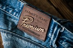 Laser cut and hot printed leather label made in Italy by Panama Trimmings #denim…
