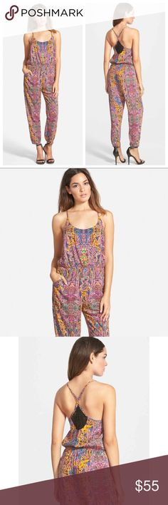 Paisley jumpsuit Gorgeous spaghetti strap jumpsuit. Lace detailing on back. Synched waist. Elastic ankles for perfect fit. Stunning paisley design throughout entire piece. boutique Pants Jumpsuits & Rompers