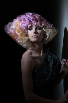 Big Waves of pastel orange, pink, purple, blue, and platinum blonde. North American Hairstyling Awards (NAHA)