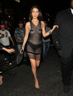 "Bella Hadid Style: 55 of her best outfits to copy right now | sheer naked dress with ""tape"" pasties"