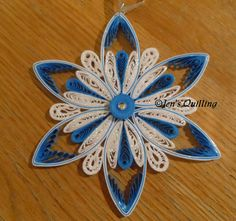 Handcrafted quilled snowflake ornaments - made from my original design. Made with high quality acid free paper. The snowflakes have been varnished