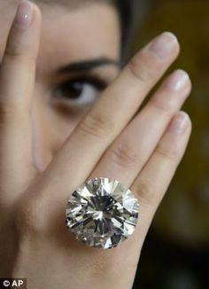 A Sotheby's employee with one of the world's largest known round brilliant-cut diamonds we...