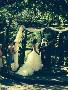 Jessica and Jonathan at the alter with Mike Wakefield, officiant at Hidden Creek