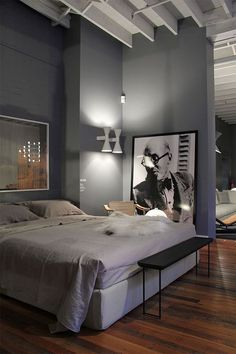 Grey walled double-volume bedroom interior - via www.murraymitchell.com