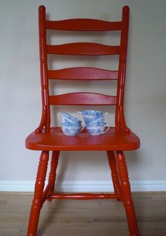 Paint thrift store chairs red & maybe some teal... looks great around kitchen table mix matched with my leopard print chairs