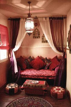 i'm doing this-LOVE-create a nook like this by suspending curtain rods from the ceiling.