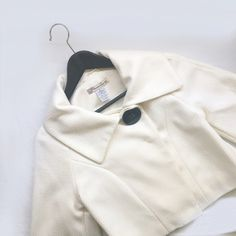 Cropped cape Super adorable cream cropped cape jacket. The inside button is loose as shown in the last picture but everything else is still great! Lightly used. No trades American Rag Jackets & Coats Capes