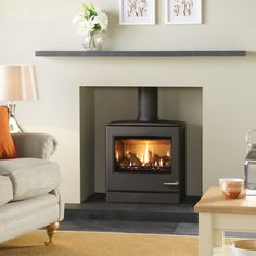 The largest in the Yeoman range of CL gas stoves, the Yeoman Natural Gas Stove Conventional Flue Top Exit in Matt Black has the same gently curving lines, control options and sophisticated stainless-steel features as its smaller counterparts. Gas Fire Stove, Gas Stove Fireplace, Wood Burner Fireplace, Wood Burning Fireplace Inserts, Fireplace Ideas, Gas Fireplaces, Fireplace Hearth, Gas Fires, Fireplace Surrounds