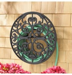 wrought iron for hose  | water hose running through our yard or patio when not in use. A hose ...