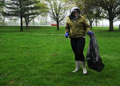 Iowa State University ROTC Army member Shannon Writt  picks up trash during Stash the Trash at Stuart Smith Park on Saturday in Ames. Photo by Nirmalendu Majumdar/Ames Tribune