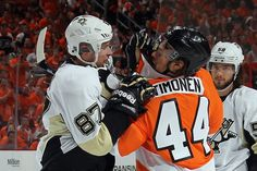 Sidney Crosby # 87 and # 44 Kimmo Timonen compete at the 3rd game of the series of Round 1, Sunday, April 15. (Photo by Bruce Bennett / Getty Images)