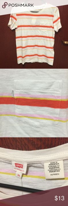 NWT Levi's Striped Pocket Tee Brand new with tags. Never worn or tried on. Super cute chest pocket with Levi's logo trim. Genuine item. Orange, pink, yellow, white shirt. Only flaw is a pair of (factory) holes in the back of the shirt from what appears to be the tag. Price has been lowered to reflect condition, and is firm.   * always same day shipping  * smoke free home  * pet-free except dwarf hamster * price firm on this listing   * no trades, please  * thank you for your consideration…