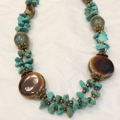 HP Beaded brown and turquoise necklace Great necklace, NWOT. perfect condition. Also have the earrings available as a $18 bundle. HP 9/12 Statement Style Jewelry Necklaces