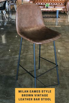 The Milan Bar Stool is inspired by the timeless mid-century designs of Charles & Ray Eames. The solid laminated bent wood shell has multiple layers of foam upholstered in vintage brown PU leather, tailored to fit your body, making it a lasting pleasure to sit on. It takes on a new approach to the classic DSW chair, switching out the Eiffel leg design for a solid minimalist metal structure powder coated in a matte black finish. The Milan bar stool adds a splash of vintage comfort to any room. Metal Chairs, Bar Chairs, Milan Bar, High Bar Stools, Ergonomic Computer Chair, Leather Counter Stools, Chair Leg Floor Protectors, Bent Wood, Metal Structure