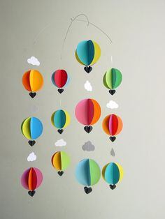 The bright shades of this hand-made hot air balloon mobile are perfect to add a touch of happiness and a ton of colour to your babys nursery. In even the slightest breeze the balloons whirl and twirl, causing a riot of colour that will delight and enchant your little one. A beautiful