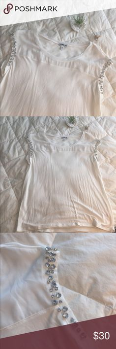 "NWOT tee from Express White tee from Express.   Front has a mesh like detail and gems shown on.   All gems are intact.   Measures approximately 18""armpit to armpit, 22.5"" shoulder to bottom hem.   Will ship same or next day 🥂 Express Tops Tees - Short Sleeve"