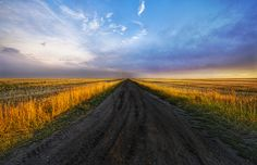 After an accident on an ATV, I was stuck on this road for a long time while waiting to for rescue.  Luckily, the camera and tripod were uninjured and the time I was waiting for happened to be sunset.  There are worse things in life than this!    - Montana, USA   - Photo from #treyratcliff Trey Ratcliff at http://www.StuckInCustoms.com