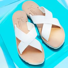 For sandals, try a pair of sporty slides to give an outfit a relaxed edge.