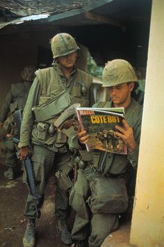 USMC looking at the photos in French magazine Match, in Hue City, 1968 ~ Vietnam War