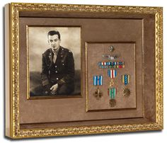 Military photograph framed with medals.
