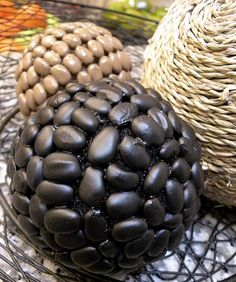 DIY decorative balls - styrofoam or other lightweight round balls; jute or rope, or dried beans and spray paint.
