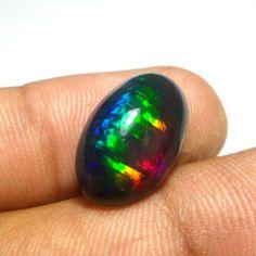 10.50 cts natural VVS top neon  multi color play Ethiopia  black opal cabochon
