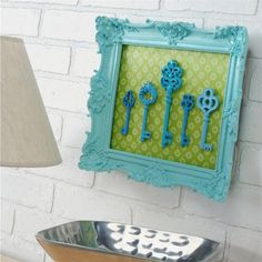 Peacock Blue Keys - I want to do this with a bigger frame and adding old crystal doorknobs to the bottom where you can hang your keys and coat for then entry way