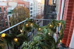 Supplied with fresh garlands and white lights, we brought holiday cheer to a fire escape in Manhattan's East Village. And we have a few ideas for your fire escape too: