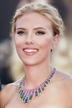 This necklace complements her minimal makeup and light hair. Colors are perfect for her and the design looks great with her strapless outfit.