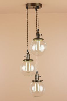 3 Light Chandelier - Cascading Pendant Lights - with 6 inch Clear Glass Globes - Oil Rubbed Bronze Finish - Edison Light Bulbs. $298.00, via Etsy.