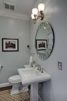 The average person's line of sight is roughly 5 feet, so making sure the center of the mirror is 5 feet off the floor is a good rule of thumb.