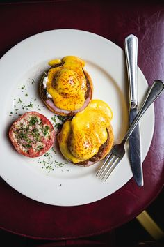 Brennan's Eggs Hussarde - For an epic weekend brunch, try a twist on eggs Benedict that incorporates a rich red wine sauce draped over poached eggs and Canadian bacon.