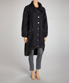 Bursting with bold buttons and a wide collar, this coat will jump to mind each time an ensemble needs extra warmth. Its hip hi-low silhouette and billowy sleeves make it a cut above other cozy numbers.Measurements (size M): 42'' from high point of shoulder to hem62% polyester / 35% cotton / 3% spandexHand wash