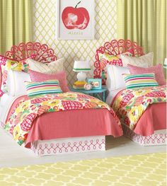 We love this bright floral vintage flair girl's bedroom.  The peacock wicker headboards and the apple print art add such a cheerful vibe.