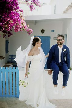 Love the bright pinks, blues, and whites in this destination wedding off the coast of Spain! Photo: Bikini Birdie / Venue: 10.7 Formentera / Event Planning & Design: Yolanda of #BlueCharmWeddings / Floral Design: Kentia Formentera / Dress, Veil: Le Spose De Gio / Suit, Shirt: Lorenzo Albrighi