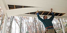 A ceiling is better than bare joists. Finish the underside of the deck when the area will be used as outdoor-living space. The beam and gutter get wrapped first with aluminum or vinyl coil stock for a clean look. The joists are covered with vinyl soffit stapled into place. Tongue and- groove boards or plywood also can be used.