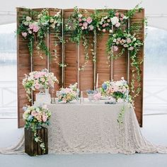 a vintage wooden folding screen with lush greenery and blooms for a refined touch