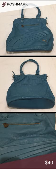Puma blue gym bag! Great Puma gym shoulder bag! Featuring a zip pocket in the front and an additional zip pocket inside. Also has two extra pockets inside to store phone and keys. Great for carrying to the gym or for everyday use! Pretty blue color and in great condition! Puma Bags Shoulder Bags