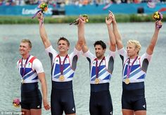 Medal of honour: Pete Reed, Andrew Triggs Hodge, Alex Gregory and Tom James celebrate with their medals