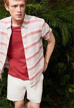 Going casual, Linus Wordemann sports a Club Monaco short-sleeve stripe shirt $98.50, pocket tee $32.50, and shorts $69.50.