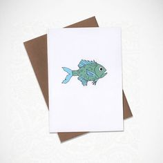 Here fishy, fishy, fishy!! This greeting card was illustrated by me and made with love. Perfect for any occasion!  CARD DETAILS: -Standard A2 folded card. -Comes with an A2 Grocery Bag Brown Envelope. -Professionally printed on heavyweight 16pt, sustainably sourced paper stock. -Each card is scored, ensuring a clean fold. -Blank inside for you to write a personal message. -Comes packaged inside a protective cellophane sleeve.  FREE SHIPPING! SHIPS within 1-3 Business days.  Feel free to ask…