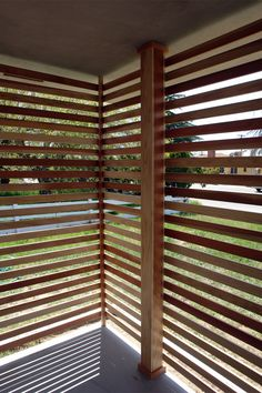 Slat screen. Put them closer together for shade purposes, or alternate front and back? Allow breeze to flow through!