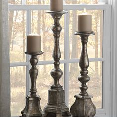 """Want to stay on-trend this autumn? Then we've got two words for you, """"metallic accents."""" Look no further than our speckled bronze and antique silver finished Speckled Metallic Candlesticks. These are bound to give any room in your house a sophisticated shine."""