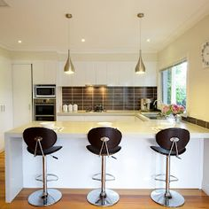 Modern Kitchen in a laminate in a silk finish with Caesarstone bench tops .