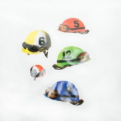 Derby Days.  Jockey Helmet Wall Clings are the perfect decorations for your favorite horse enthusiast.  Display these helmet clings during your Derby celebration or horse event and be the front runner of party throwing.  Window cling sheet is approximately 12″ x 17″.  10 helmet decorations per sheet.  Assorted jockey helmets on every sheet.  Clings are removable and require no adhesives.  Made in the USA.  Bet on horse, jockey, and Derby party supplies for your upcoming racing gathering…