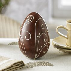 Milk Chocolate Woodland Fern Egg | £5.50 | A Swiss Grand Cru milk chocolate egg with an elegant hand-piped white chocolate woodland fern design and stippled with dark chocolate.