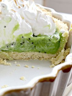 Refreshing tart with zesty kiwi fruit curd and sweet marshmallowy swiss meringue.ingredientsfor the pastry:250 g plain flour125 g cold unsalted butter1 medium