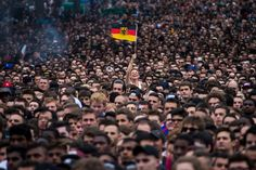 Friday's World Cup match between Germany and France made for a sea of sullen faces in Paris. But at a public viewing, amidst the crowd of quiet, worried French fans, one ecstatic German fan waved her flag proudly and celebrated the match that would guarantee her team a place in the semi-finals.