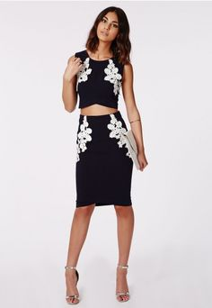 Make your season feminine with this lace #appliqué crop. Featuring beautiful white lace stitched onto a deep navy base, this curved hem crop top has made it to the top of our lust list! Style with it's matching #Missguided skirt and silver heels for a stand out co-ord look.
