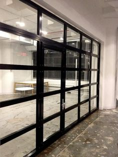Contemporary Aluminum & Clear Tempered Glass Garage Door with Passage Door - Modern Glass Garage Door, Garage Door Design, Clear Garage Doors, Metal Garage Doors, Glass Doors, Modern Garage Doors, Garage Door Springs, Garage Door Makeover, Garage Renovation